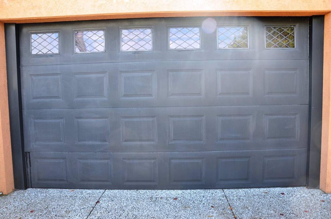Black garage panel door heavily faded & oxidized
